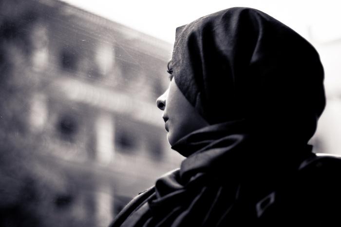Muslim Woman Alone